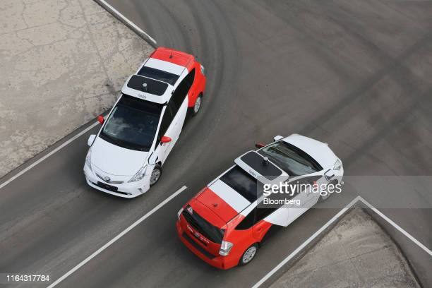 Driverless Toyota Motor Corp Prius hybrid cars operated by YandexTaxi part of YandexNV take part in selfdriving taxi trial on a test track in...