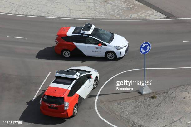 Driverless Toyota Motor Corp Prius hybrid cars operated by YandexTaxi part of YandexNV take part in a roudabout simulation during a selfdriving taxi...