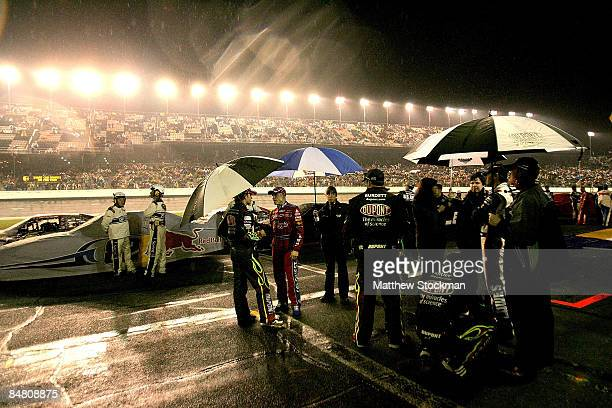 Drivers and crew members wait out a rain delayduring the NASCAR Sprint Cup Series Daytona 500 at Daytona International Speedway on February 15, 2009...