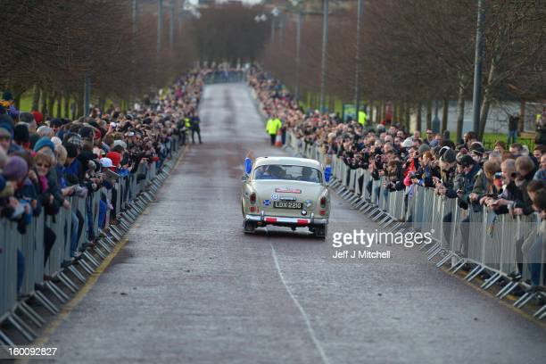 Drivers and their classic cars leave Glasgow at the start of the Monte Carlo Classic Rally on January 26, 2013 in Glasgow. Around 100 cars set off...