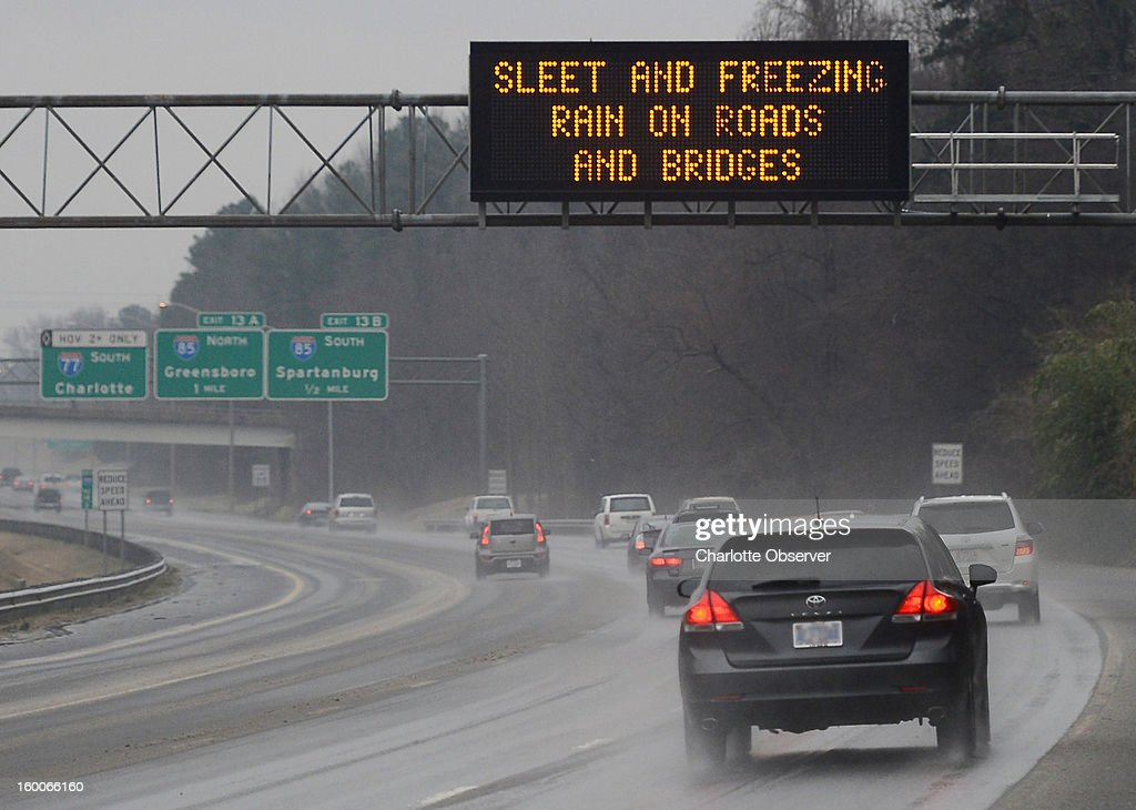 Drivers are alerted to sleet and freezing rain on the roads and bridges in Davidson, North Carolina, on Friday, January 25, 2013 as they travel on I-77 South toward the interchange with I-85 North and South.