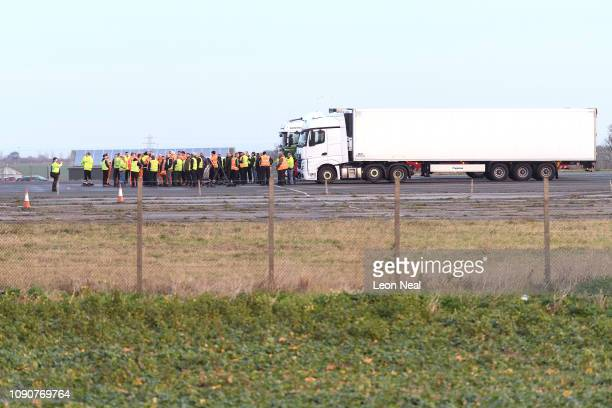 Drivers are briefed at the front of a long row of hired haulage trucks on Manston airport as the Government carries out tests on the local road...