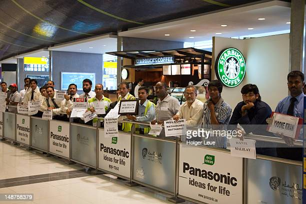Drivers awaiting passengers outside arrivals hall at Abu Dhabi International Airport.