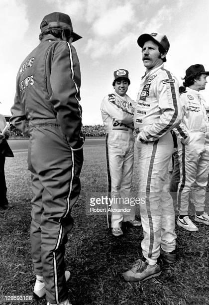 NASCAR drivers Bill Elliott Harry Gant Dale Earnhardt Sr and Morgan Shepherd await drivers' introductions prior to the start of the 1982 Daytona 500...
