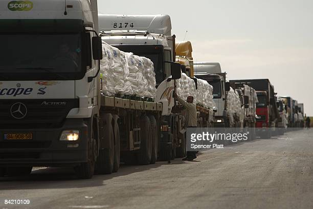 Drivers carrying humanitarian relief to be shipped into Gaza at the Rafiah border crossing get into their trucks January 8 2009 along the IsraeliGaza...
