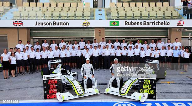 Drivers Champion Jenson Button of Great Britain poses with team mate Rubens Barrichello of Brazil and the rest of his Constructors Championship Brawn...