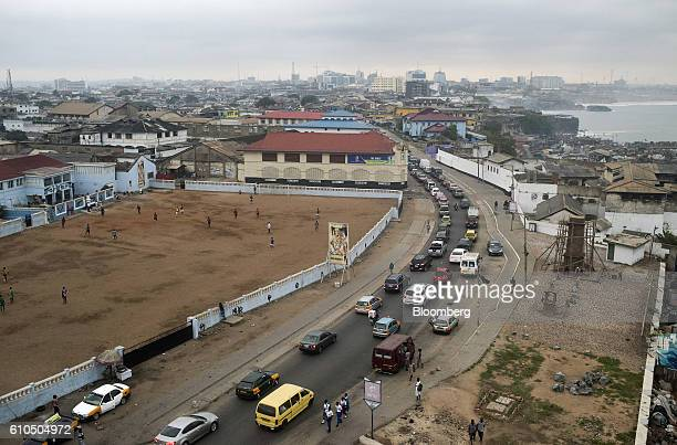 Drivers commute to work early morning in Accra Ghana on Tuesday Sept 20 2016 Ghana's central bank expects mergers and acquisitions among lenders to...