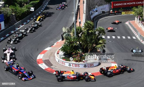 TOPSHOT Drivers compete at the start of the Monaco Formula 1 Grand Prix at the Monaco street circuit on May 28 2017 in Monaco / AFP PHOTO / Bertrand...