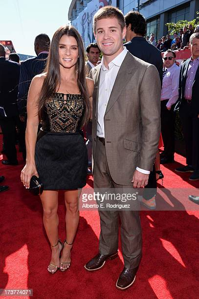 NASCAR drivers Danica Patrick and Ricky Stenhouse attend The 2013 ESPY Awards at Nokia Theatre LA Live on July 17 2013 in Los Angeles California