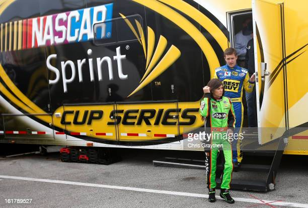 Drivers Danica Patrick and Ricky Stenhouse Jr leave a rookie meeting prior to practice for the NASCAR Sprint Cup Series Sprint Unlimited at Daytona...