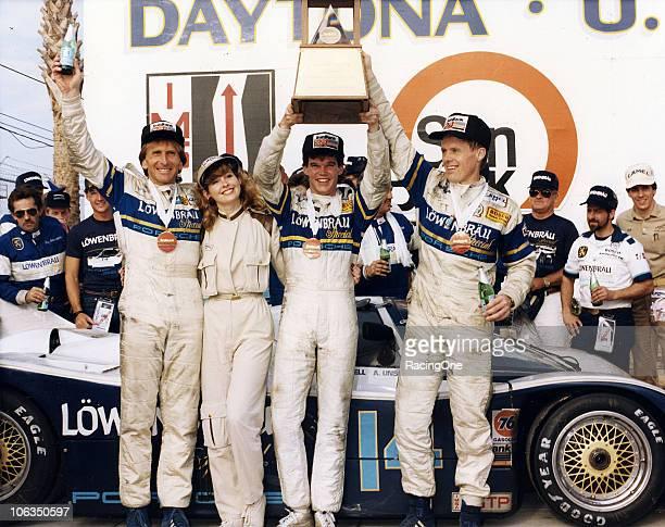 Drivers Derek Bell, Al Unser, Jr. And Al Holbert celebrate in victory lane after driving HolbertÕs Lowenbreau-sponsored Porsche 962 to victory in the...