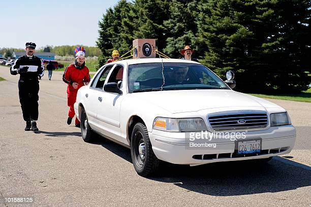 Drivers dressed up as the Village People sing the song Macho Men as they follow a judge's car after committing an ontrack violation during the 24...