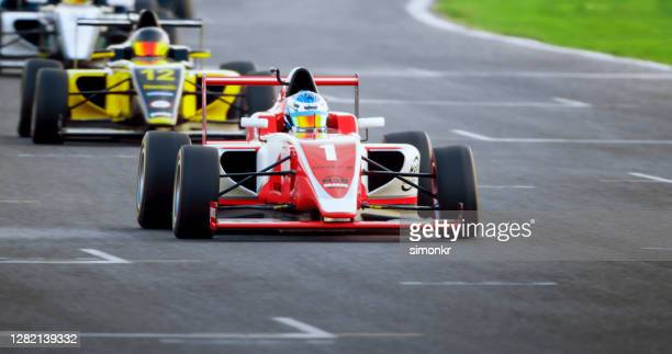 drivers driving racing cars - motorsport stock pictures, royalty-free photos & images