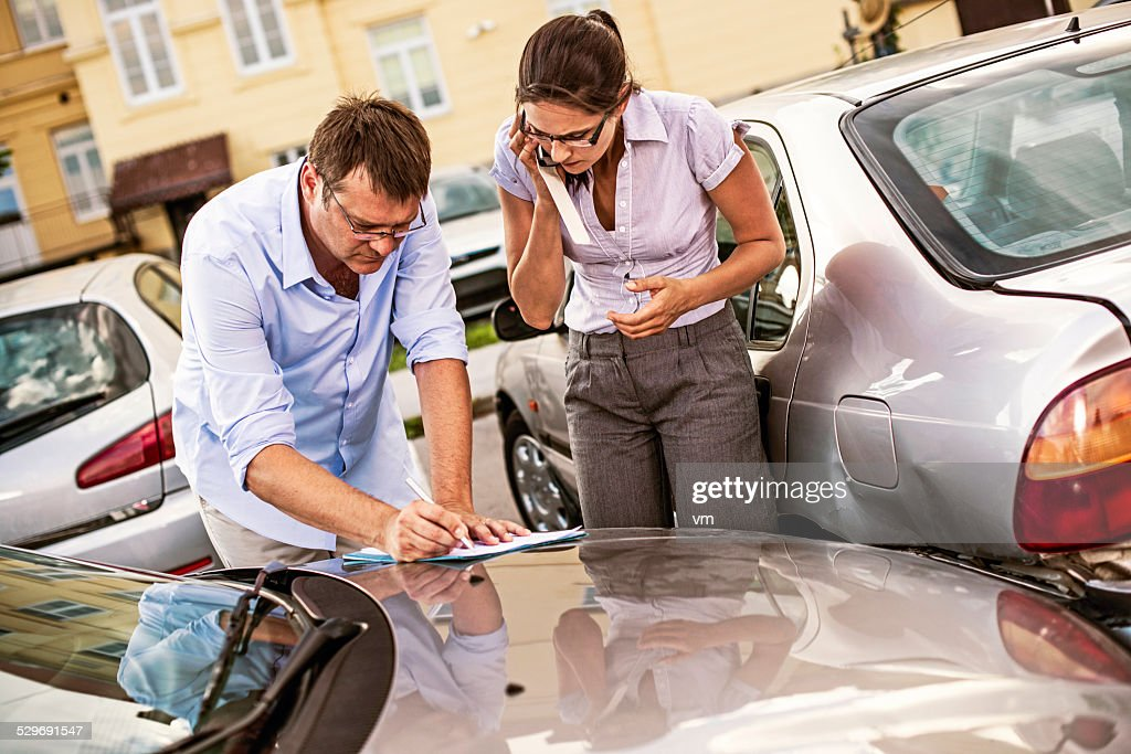 Drivers Fill Out an Accident Report : Stock Photo