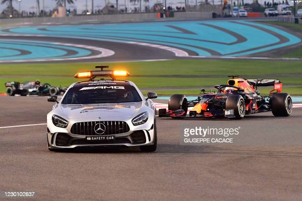 Drivers follow the safety car during the Abu Dhabi Formula One Grand Prix at the Yas Marina Circuit in the Emirati city of Abu Dhabi on December 13,...