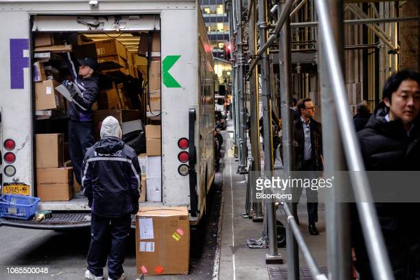 Drivers for an independent contractor to FedEx Corp unload packages from a delivery truck in New York US on Monday Nov 26 2018 Americans spent $506...