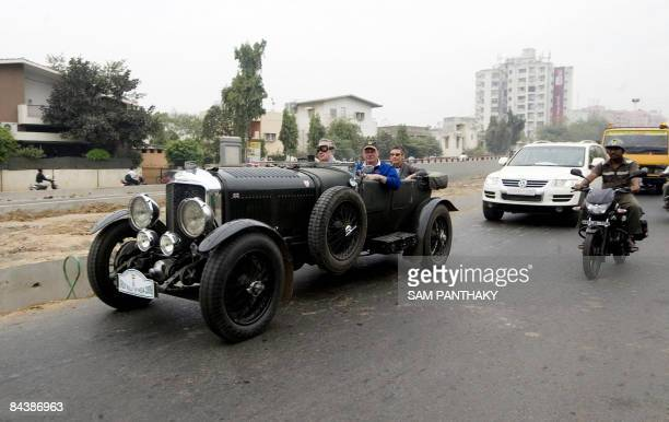 Drivers from Britain's Benjafield Racing Club drive their 1920's Bentley along a street in Ahmedabad on January 21 2009 Prince Michael of Kent and a...