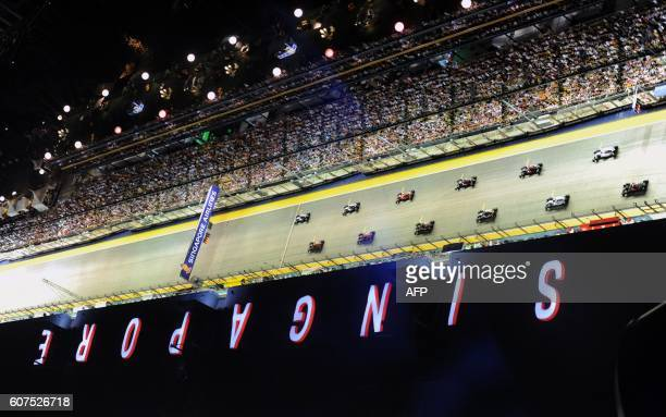 TOPSHOT Drivers gather at the start line of the Formula One Singapore Grand Prix in Singapore on September 18 2016 / AFP / ALLAN LEE