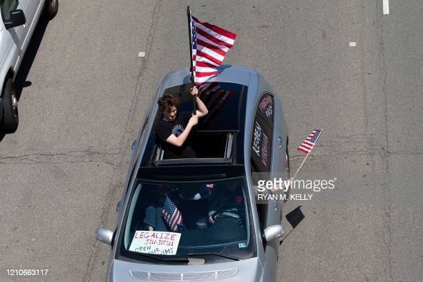 Drivers honk their horns during a reopen Virginia rally around Capitol Square in Richmond on April 22 2020 Protesters were opposed to the stayathome...