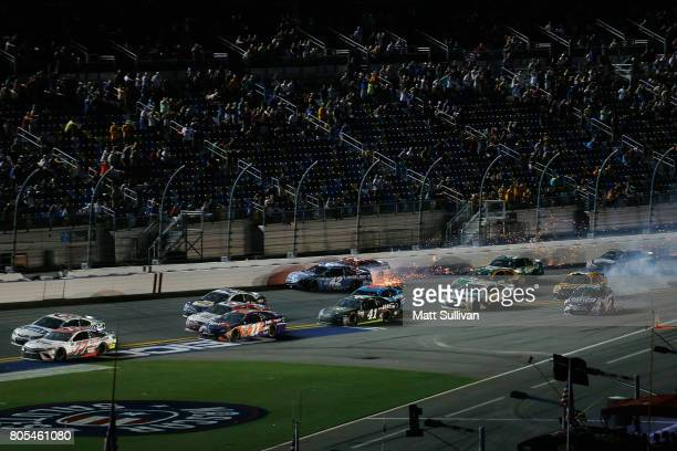 Drivers including Kyle Larson driver of the Credit One Bank Chevrolet Ryan Blaney driver of the Motorcraft/Quick Lane Tire Auto Center Ford Matt...