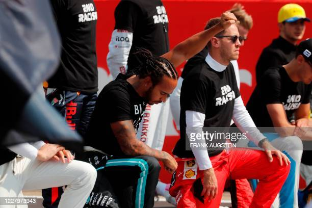 Drivers including Mercedes' British driver Lewis Hamilton take a knee to protest against racism ahead of the F1 70th Anniversary Grand Prix at...