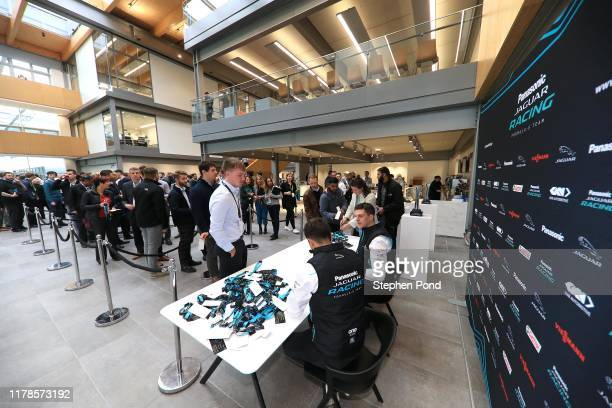 Drivers James Calado and Mitch Evans sign autographs during the Panasonic Jaguar Racing Season 6 Launch on October 02 2019 in Gaydon England