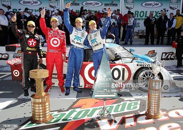 Drivers Juan Pablo Montoya Dario Franchitti Memo Rojas and Scott Pruett of the Telmex Chip Ganassi team Racing celebrate their victory in the Rolex...