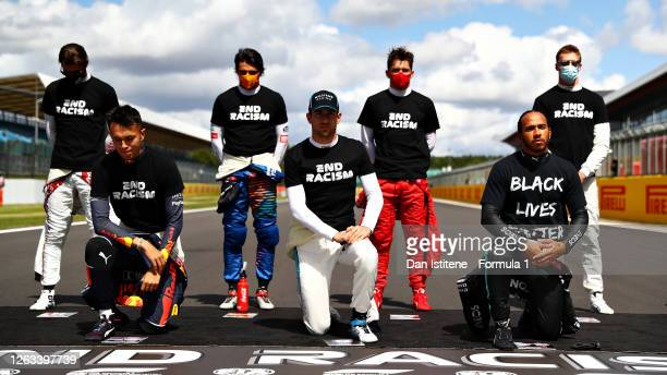 Drivers kneel on the grid in support of the Black Lives Matter movement before the F1 Grand Prix of Great Britain at Silverstone on August 02, 2020...