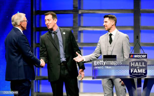 NASCAR drivers Kyle Busch and Denny Hamlin congratulate Joe Gibbs during the 2020 NASCAR Hall of Fame Induction Ceremony at Charlotte Convention...