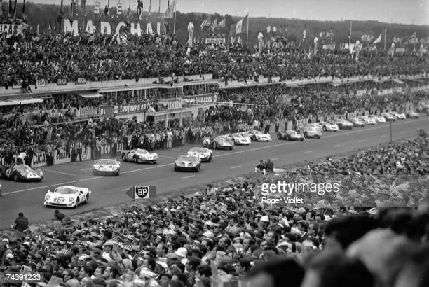 Drivers leave the start of the 24 Hours race of Le Mans at Circuit de la Sarthe on June 18 1966 in Le Mans France