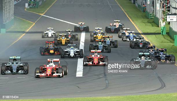 Drivers leave the starting grid during the start of the Formula One Australian Grand Prix in Melbourne on March 20 2016 / AFP / SAEED KHAN / IMAGE...