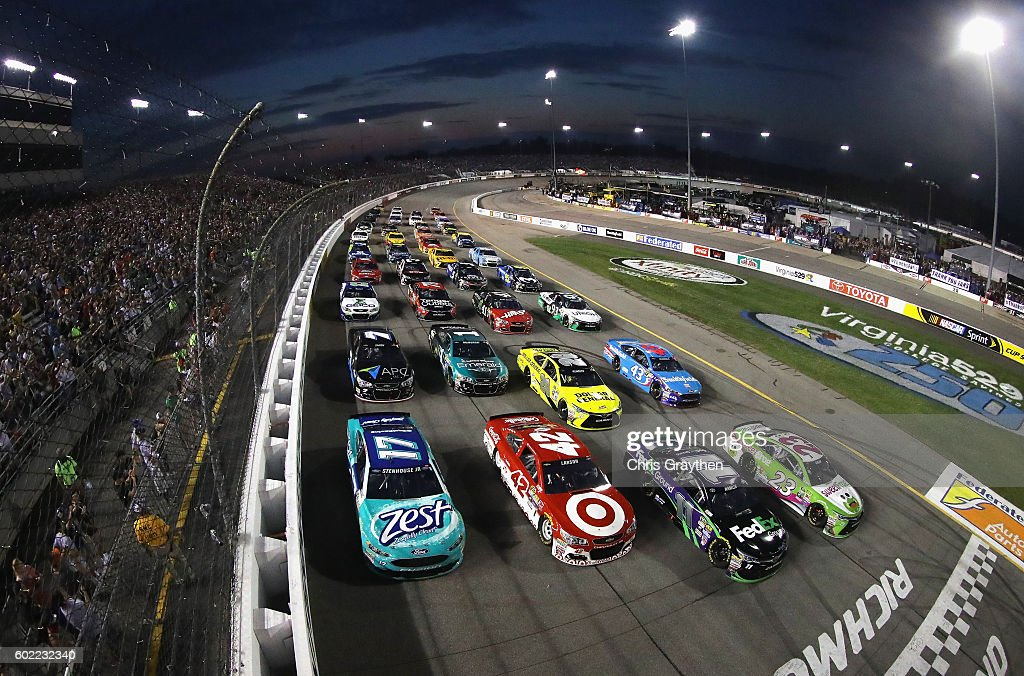 Drivers line up in a four-wide formation to salute fans during the inaugural Fan Appreciation Weekend prior to the start of the NASCAR Sprint Cup Series Federated Auto Parts 400 at Richmond International Raceway on September 10, 2016 in Richmond, Virginia.