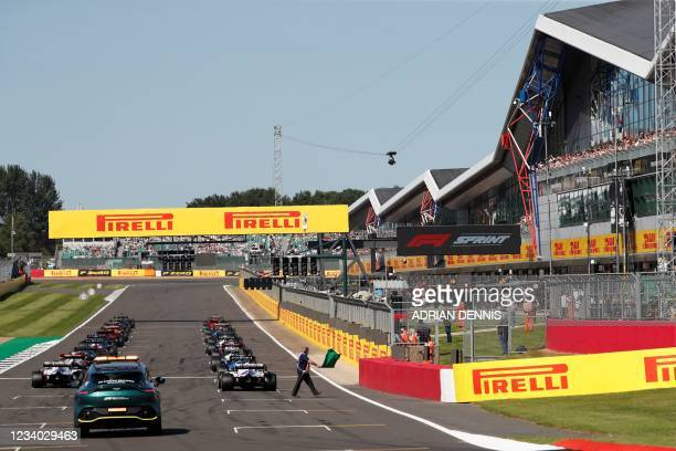 Drivers line up on the start grid at the start of the sprint session of the Formula One British Grand Prix at Silverstone motor racing circuit in...