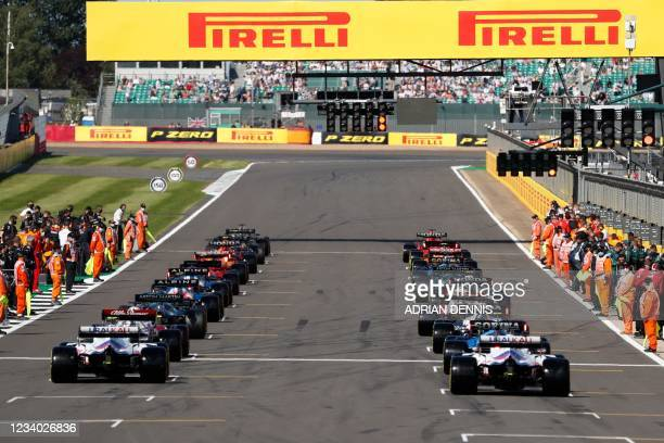 Drivers line up on the starting grid ahead of the sprint session of the Formula One British Grand Prix at Silverstone motor racing circuit in...