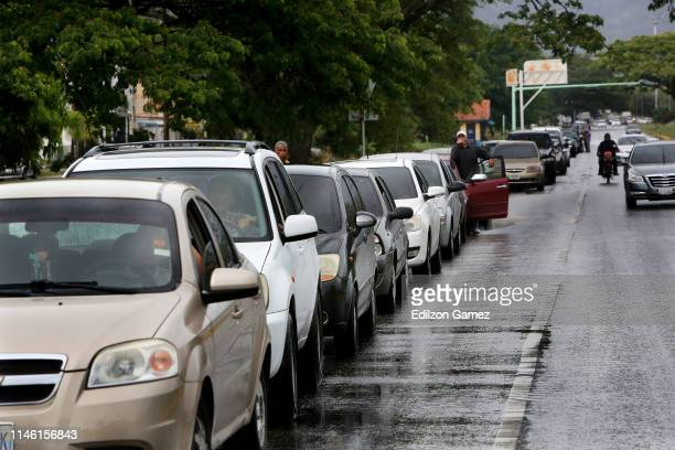 Drivers make a long line outside a gas station during a fuel shortage on May 24 2019 in Valencia Venezuela Main reasons of the shortage are the...