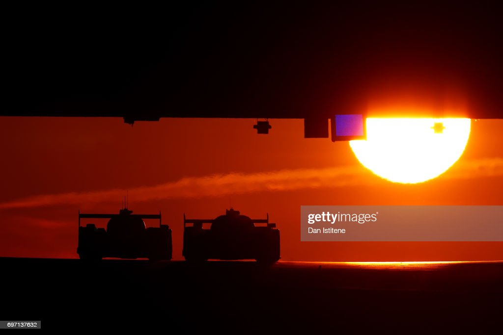 Drivers make their way under Dunlop Bridge a sunrise during the Le Mans 24 Hour Race at Circuit de la Sarthe on June 18, 2017 in Le Mans, France.