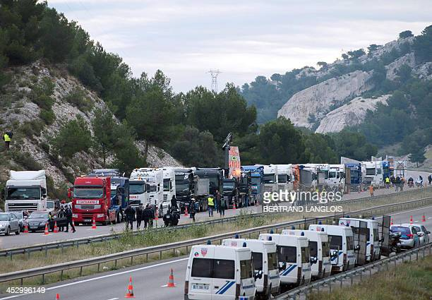 Drivers of heavy goods vehicles block a section of highway A55 during a demonstration against the ecotax in ChateauneuflesMartigues southern France...