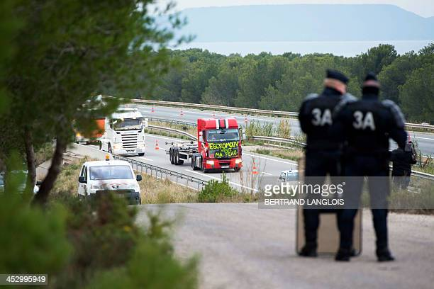 Drivers of heavy goods vehicles demonstrating against the ecotax block a section of highway A55 next to a bridge with radars set up to collect the...