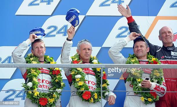 Drivers of the Audi R18 E-Tron Quattro N° 2, British Allan Mcnish, Italian Rinaldo Capello, Danish Tom Kristensen and Audi Motorsport director Dr...