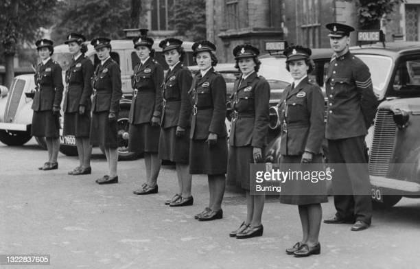Drivers of the Bedford Women's Auxiliary Police Corps stand to attention during an inspection parade on 1st August 1942 in Bedford, Bedfordshire,...