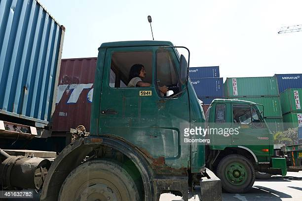Drivers operating trucks transport shipping containers at the Tanjung Priok port, operated by state-owned PT Pelabuhan Indonesia II , in Jakarta,...