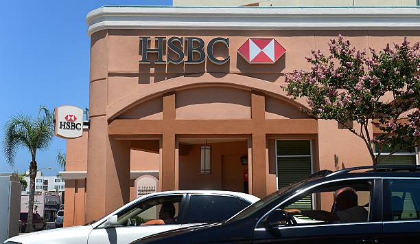 Drivers pass a branch of HSBC bank in Al Pictures | Getty Images