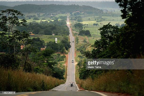 Drivers pass through deforested land along federal highway BR222 on June 9 2012 in Para state Brazil Highway construction through Amazonian...