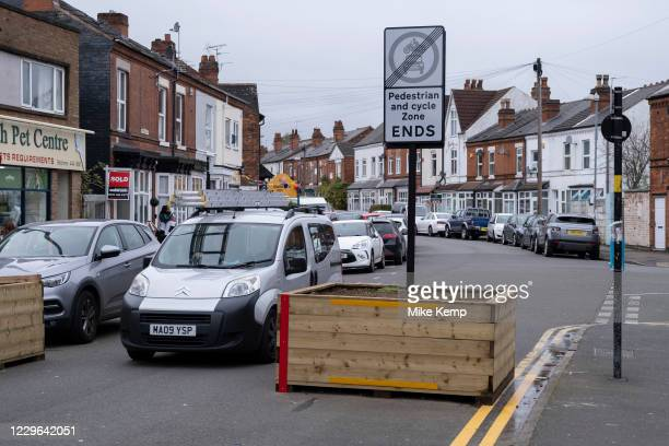 Drivers pass through Low-traffic neighbourhood barriers put in place in Kings Heath on 16th November 2020 in Birmingham, United Kingdom. These...