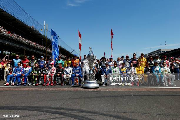 Drivers pose for a group photo before the start of the 98th running of the Indianapolis 500 at Indianapolis Motorspeedway on May 25 2014 in...