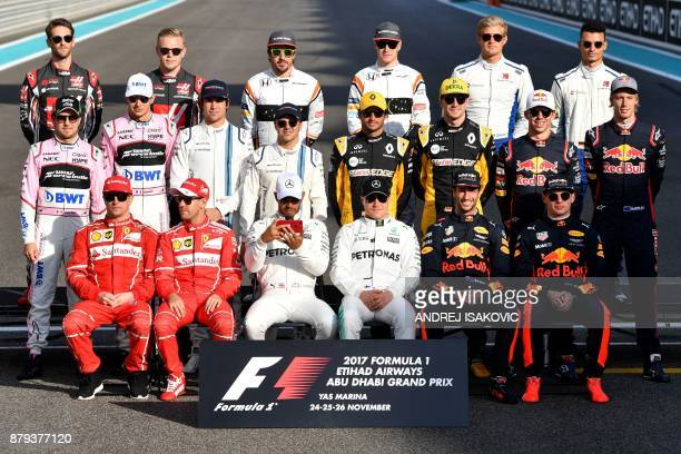 Drivers pose for a group picture ahead of the Abu Dhabi Formula One Grand Prix at the Yas Marina circuit on November 26 2017 / AFP PHOTO / Andrej...