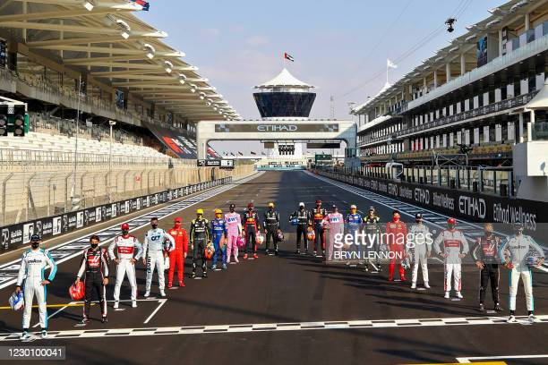 Drivers pose for the end of the year group photo on the starting grid ahead of the Abu Dhabi Formula One Grand Prix at the Yas Marina Circuit in the...