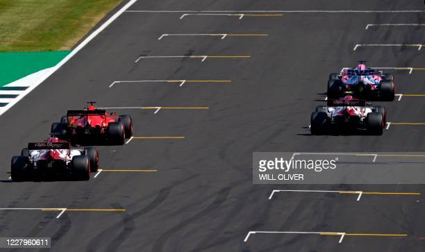 Drivers position their cars on the grid to practice a start at the conclusion of the third practice session of the F1 70th Anniversary Grand Prix at...