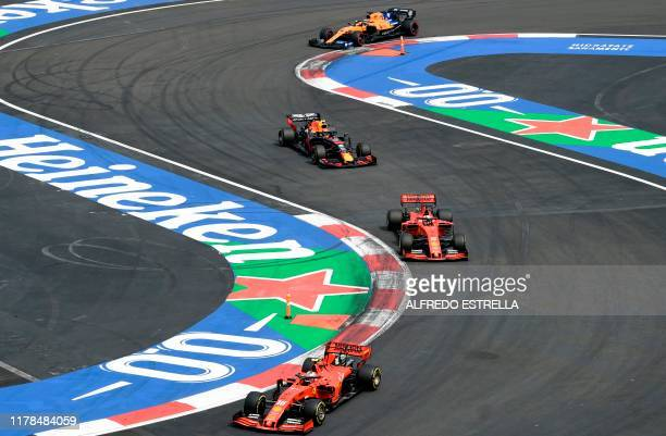 Drivers power their racing cars during the F1 Mexico Grand Prix at the Hermanos Rodriguez racetrack in Mexico City on October 27 2019
