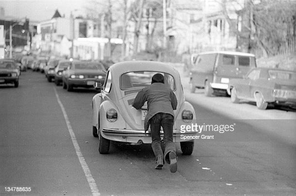 Drivers push cars to gas station during 'oil crisis' Roslindale Boston Massachusetts 1973